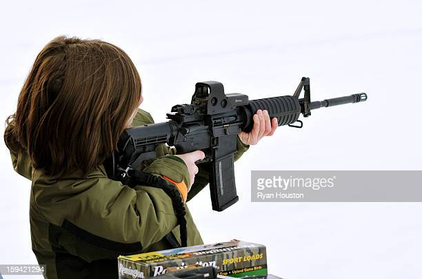 CONTENT] Young boy shoots an AR15 assault rifle with a highcapacity round magazine This is the type of magazine that gun control advocates are trying...