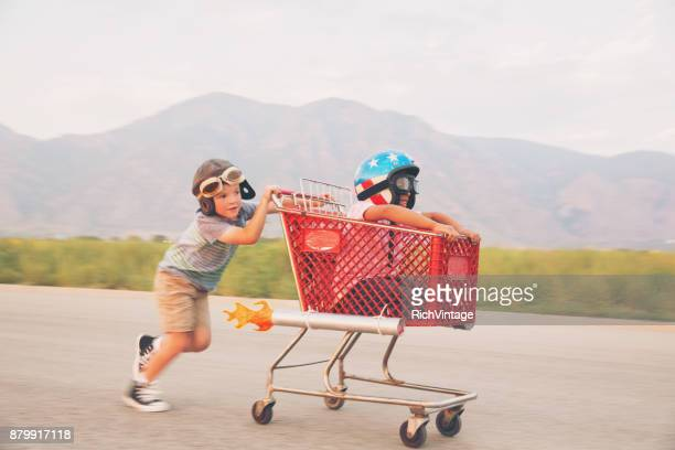 Young Boy Shopping Cart Racing Team