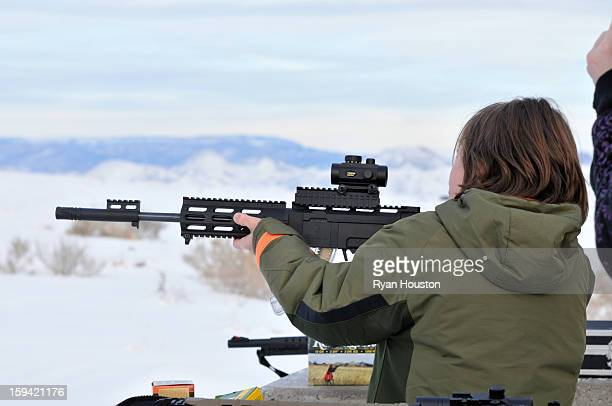 CONTENT] A young boy sights in his rifle while targetshooting in Central Utah The rifle has the appearance of an assault rifle