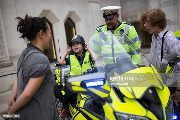 A young boy sits on a police motorbike during an opening day celebrating 175 years of policing in Guildhall Yard on July 27 2016 in London England...