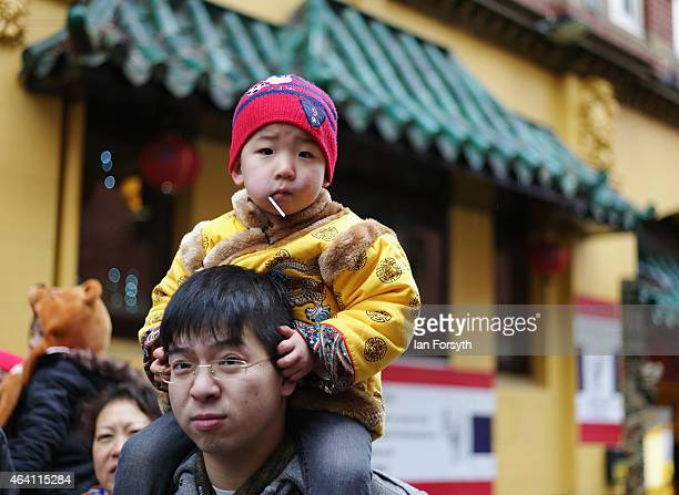 A young boy sits on his fathers shoulders as the Chinese community come together to welcome in the Chinese New Year on February 22 2015 in Newcastle...