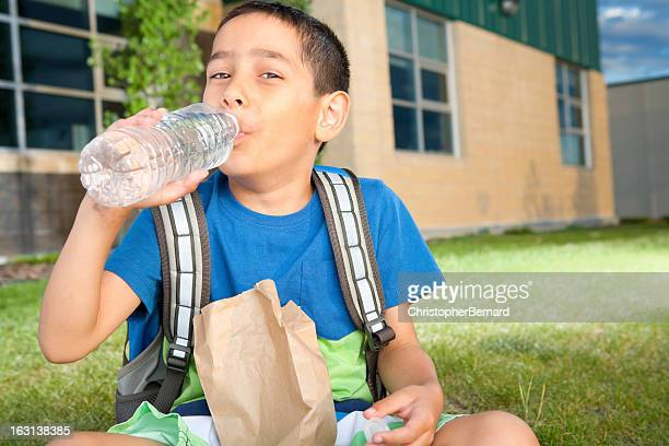 Young boy sitting at school