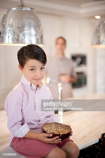 Young Boy sitting on kitchen counter