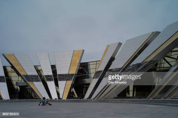 A young boy skates past the Great Patriotic War Museum on July 01 2017 in Minsk Belarus Independence Day also known as the Day of the Republic is...