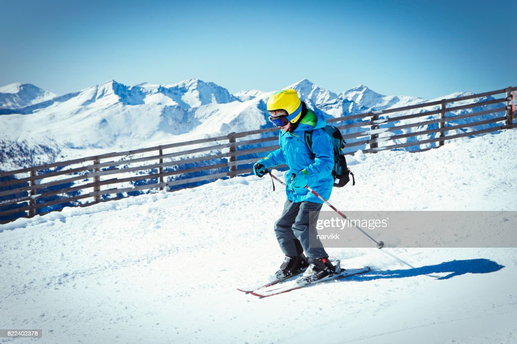 Young boy skiing in the mountains : Stock Photo