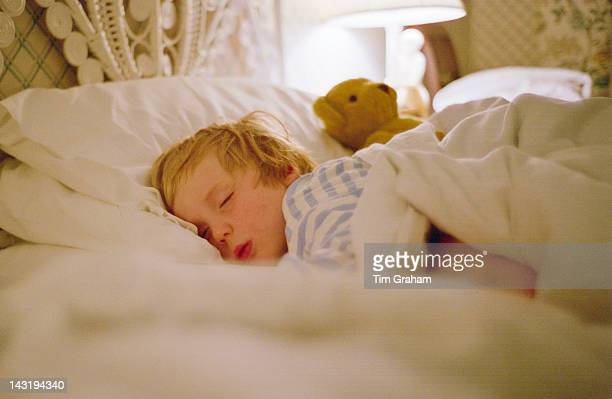 Young boy sleeping in a hotel bed Devon England