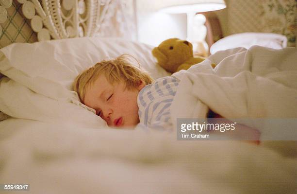 Young boy sleeping in a hotel in Devon England