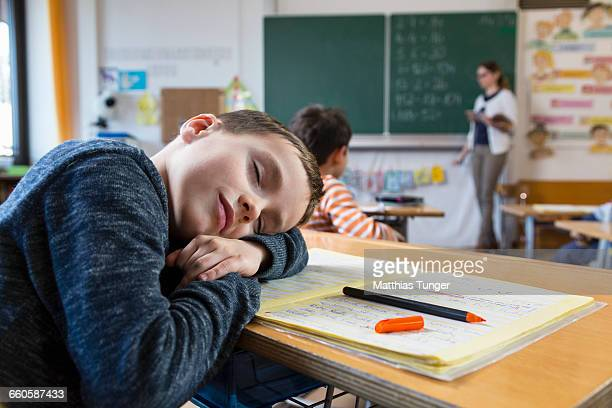 young boy sleeping in primary school