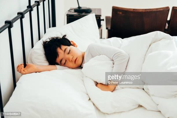 A young boy sleeping