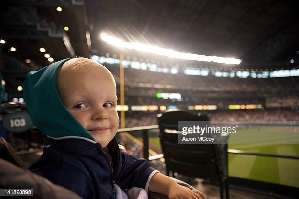 Young boy smiling at ballgame