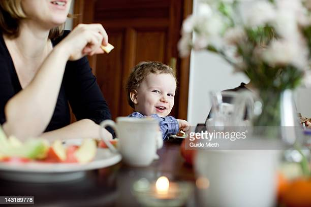 Young boy smiling on breakfast table