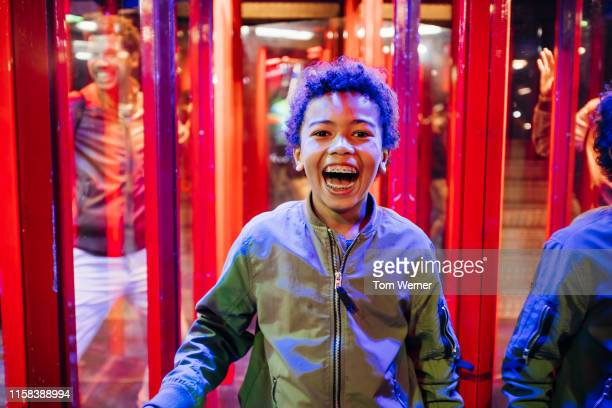 young boy smiling while in hall of mirrors - fun house stock pictures, royalty-free photos & images