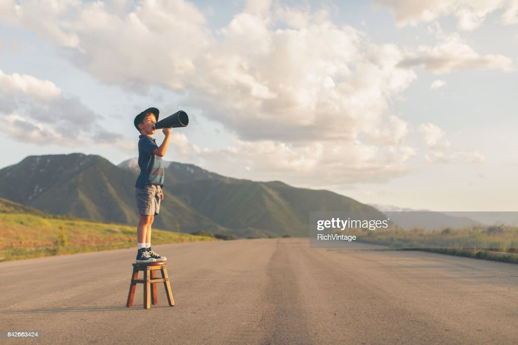 Young Boy Speaks through Megaphone : Stock Photo