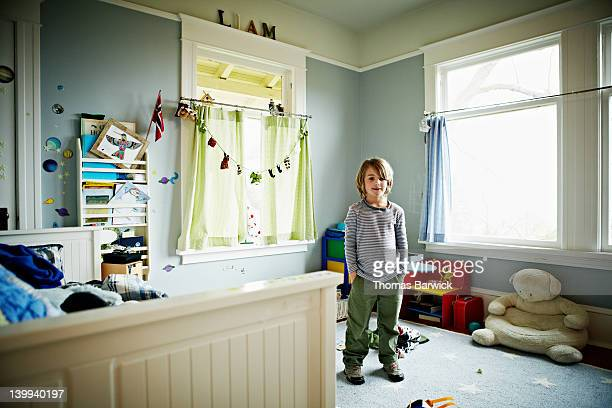 young boy standing in bedroom - childhood stock pictures, royalty-free photos & images