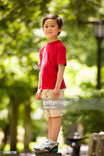 Young Boy standing on a rock