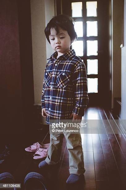 a young boy standing with some attitude. - peter lourenco stock-fotos und bilder