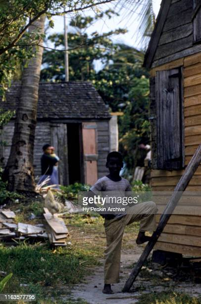 Young boy stands next to his house on April 28, 1956 in Green Turtle Cay, Abaco, Bahamas.