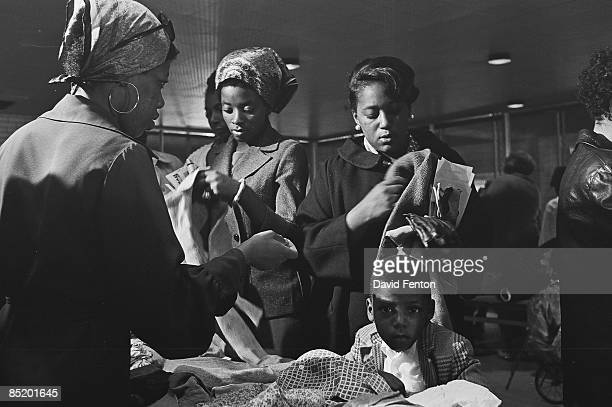 A young boy stares at the camera while members of the Black Panther Party distribute free clothing to the public New Haven Connecticut September 28...