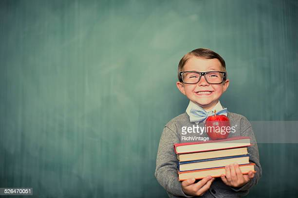 young boy student dressed as nerd holding books - blackboard stock photos and pictures