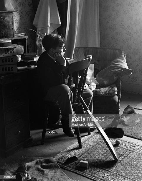 A young boy sunk into contemplation in his room at Harrow Public School Middlesex Original Publication Picture Post 5376 The School On The Hill pub...