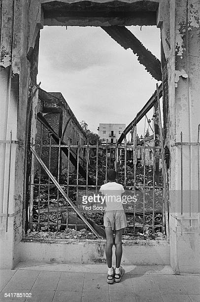 Young boy surveys the riot damage in South Central Los Angeles. Los Angeles has undergone several days of rioting due to the acquittal of the LAPD...
