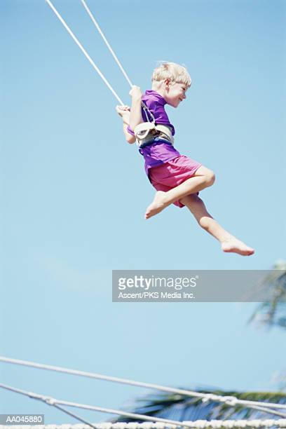 Young Boy Swinging on Trapeze