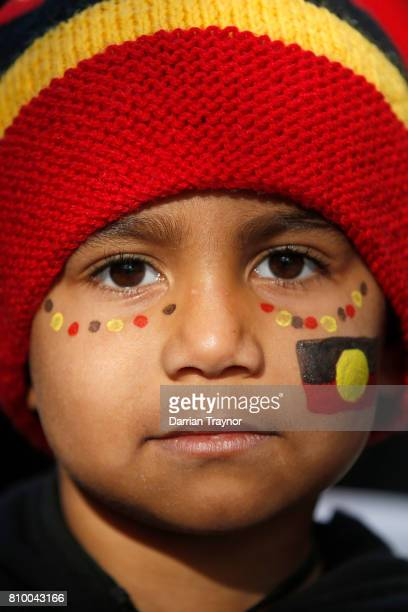 A young boy takes part in the 2017 NAIDOC March on July 7 2017 in Melbourne Australia The march was organised to call for a day of mourning and to...