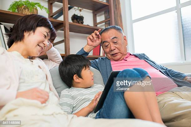 Young boy talking with grandparents