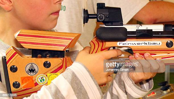 A young boy tests sporting arms during a familiy open day of shooting club 'Gut Ziel' on June 21 2009 in OlchingGeiselbullach Germany After Winnenden...