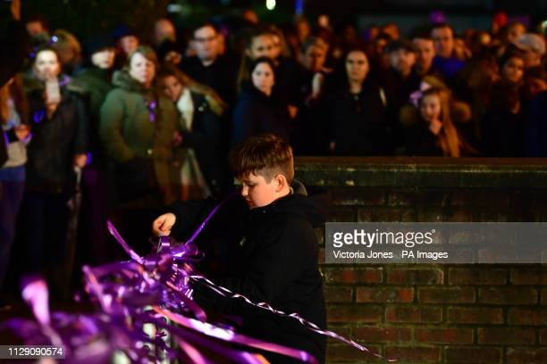 A young boy ties a ribbon in Romford town centre to protest the fatal stabbing of Jodie Chesney who was playing music with friends near a children's...