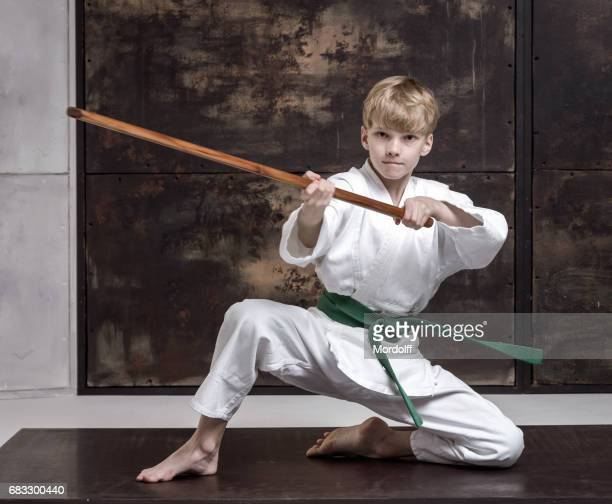 Young Boy Training With Bokken