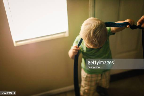 young boy trying to put on neck tie - heshphoto stock pictures, royalty-free photos & images