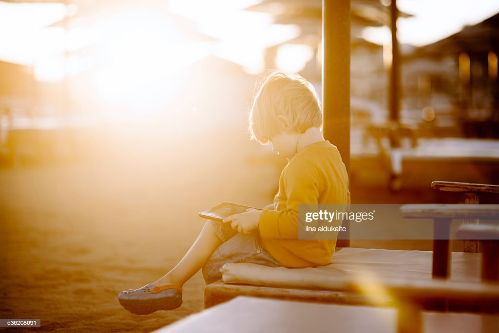 A young boy using a digital tablet : Stock Photo