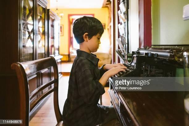 Young boy using a typewriter