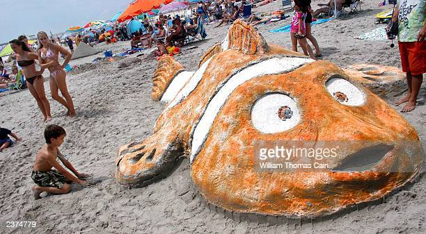 """Young boy views a """"Finding Nemo"""" sand sculpture during the 28th Annual Miss Crustacean Pageant and Hermit Crab Races August 6, 2003 in Ocean City,..."""