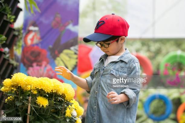 Young boy visiting garden.