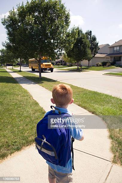 Young boy waiting for school bus