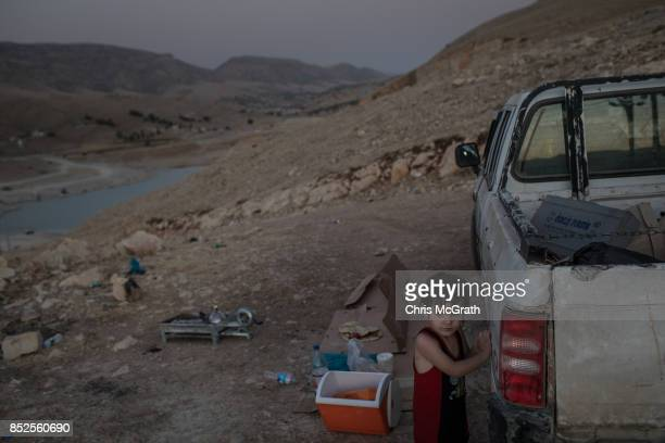 A young boy waits for is mother to dry off after swimming in Lake Dukan ahead of the upcoming referendum for independence of Kurdistan on September...