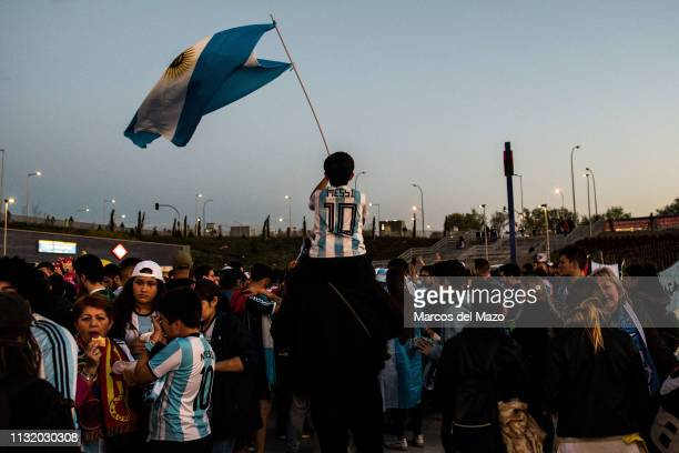 A young boy waiving Argentinian flag ahead of friendly football match between Argentina and Venezuela in Wanda Metropolitano Stadium