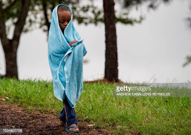 A young boy walks down a hill after he had to leave because of a fire alarm outside a Red Cross evacuation shelter in Chapel Hill North Carolina on...