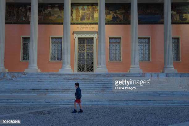 A young boy walks in front of a monument in the city center The latest datas show how youth unemployment rate in Greece is one of the highest in the...