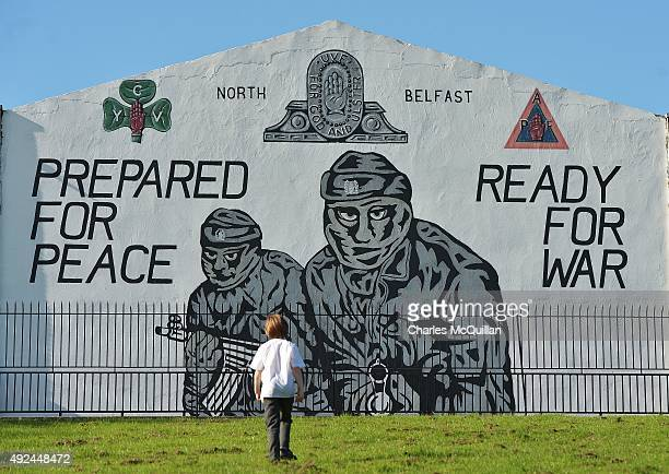 A young boy walks past a loyalist paramilitary mural on the day that the new Loyalist Community Council was launched at the Park Avenue Hotel on...