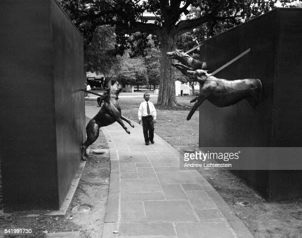 Young boy walks past a sculpture depicting a scene from when Civil Rights marchers were attacked by law enforcement dogs on February 22, 2012 at the...