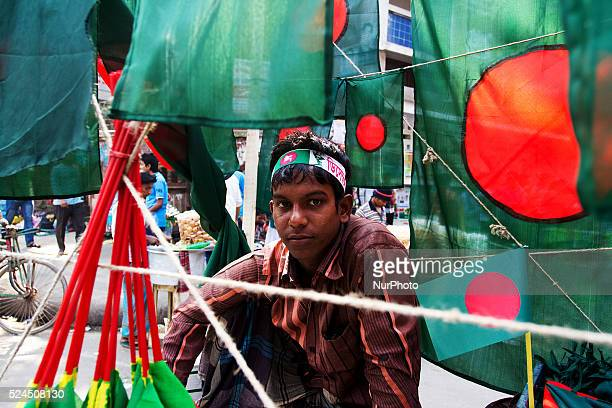 A young boy was selling Bangladeshi Flags being on the street of Dhaka University