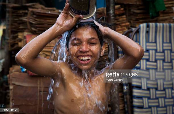 A young boy washes himself on the street The capital of the Indian state of West Bengal Kolkata is one of India's most colourful most intense and...