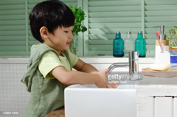 young boy washing hands - hand washing stock pictures, royalty-free photos & images