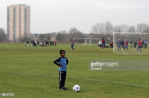 A young boy watches a Sunday League football match played on the Hackney Marshes on January 24 2010 in London England Hackney Marshes is known as the...