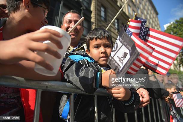 A young boy watches the annual Veterans Day Parade aka America's Parade on November 11 2014 in New York City The parade known to be our nation's...