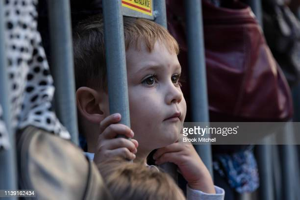 A young boy watches the ANZAC Day March on April 25 2019 in Sydney Australia Australians commemorating 104 years since the Australian and New Zealand...