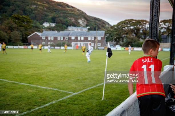 A young boy watches the game wearing a Wales Gareth Bale number 11 shirt at Barmouth Dyffryn United Football Club a Welsh football club based in the...